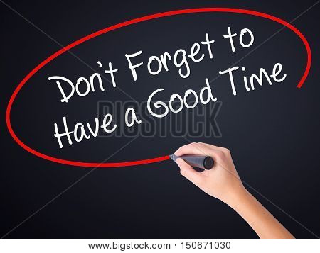 Woman Hand Writing Don't Forget To Have A Good Time With A Marker Over Transparent Board