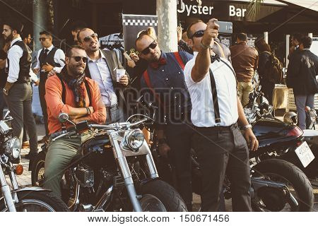 ALICANTE SPAIN - SEPTEMBER 25 2016: Motorbike racers are taking a photo with the mobile phone on the Distinguished Gentleman's Ride day a global fundraiser for prostate cancer and men's health investigation