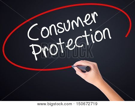 Woman Hand Writing Consumer Protection With A Marker Over Transparent Board .