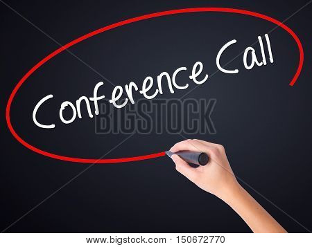 Woman Hand Writing Conference Call With A Marker Over Transparent Board .