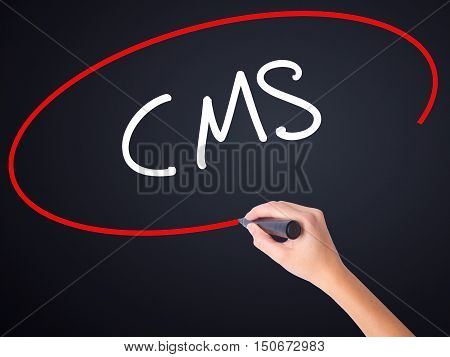 Woman Hand Writing Cms (custom Management System) With A Marker Over Transparent Board