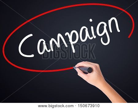 Woman Hand Writing Campaign With A Marker Over Transparent Board