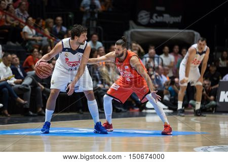 VALENCIA, SPAIN - OCTOBER 6th: Llull with ball and Diot during spanish league match between Valencia Basket and Real Madrid at Fonteta Stadium on October 6, 2016 in Valencia, Spain