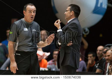 VALENCIA, SPAIN - OCTOBER 6th: (L) Referee talks with Pedro Martinez during spanish league match between Valencia Basket and Real Madrid at Fonteta Stadium on October 6, 2016 in Valencia, Spain
