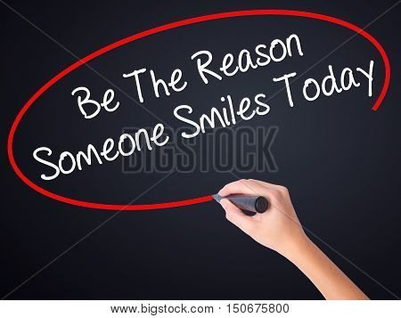 Woman Hand Writing Be The Reason Someone Smiles Today  With A Marker Over Transparent Board