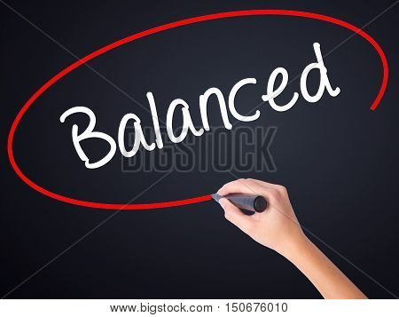 Woman Hand Writing Balanced With A Marker Over Transparent Board