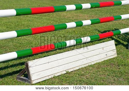 Horse Jumping Hurdle. Equestrian Sports. Green, Red and White.