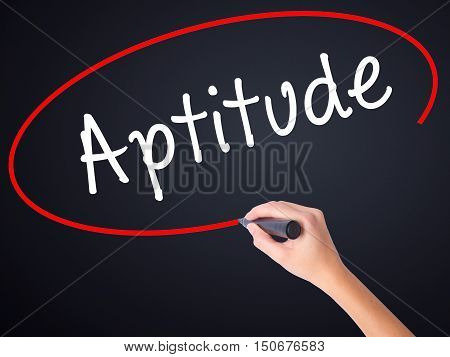 Woman Hand Writing Aptitude With A Marker Over Transparent Board