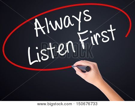 Woman Hand Writing Always Listen First With A Marker Over Transparent Board