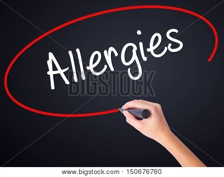 Woman Hand Writing Allergies With A Marker Over Transparent Board