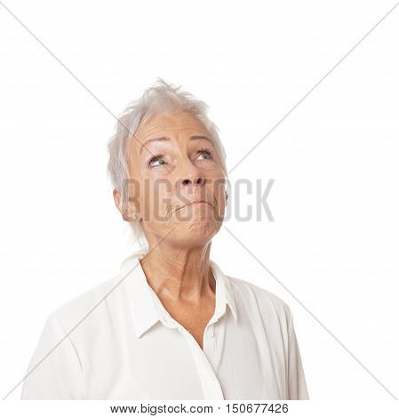 concerned senior woman looking up. isolated on white.