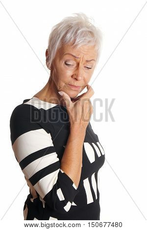 mature woman with short white hair looking troubled and forgetful. isolated on white.