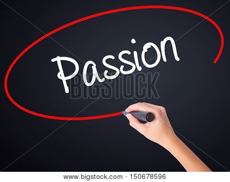 Woman Hand Writing Passion With A Marker Over Transparent Board