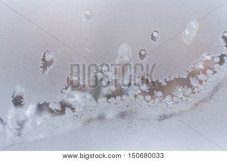 Undulating beautiful frosty pattern on frozen winter window glass.