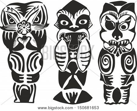 Set of three black and white New Zealand Maori totem figures - human ghosts and animalistic deities of natural forces