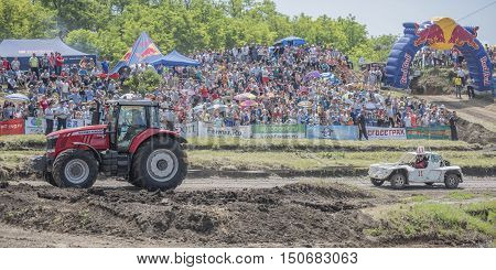 Rostov-on-Don Russia- June 05 2016: Transportation of the damaged car with a race for survival on the Bizon Track Show.Spectators watch the race