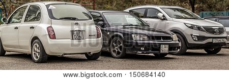 Kazakhstan, Ust-Kamenogorsk, october 5, 2016: Nissan March, Kia Sportage and Subaru Legacy, japan cars, suv, sedan, hatchback