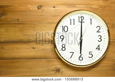 wall clock on the wooden wall at 6am or 6pm