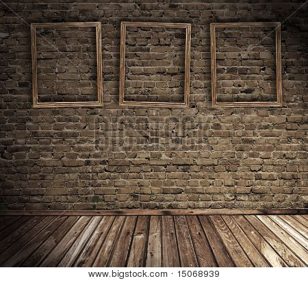 old grunge interior with blank frames against wall