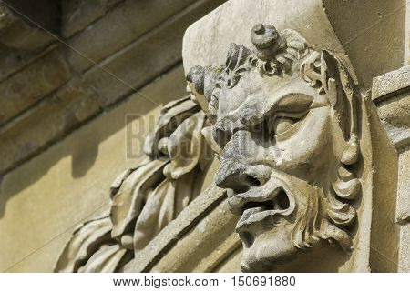 Classic Pan or the devil gargoyle feature carved in stone.