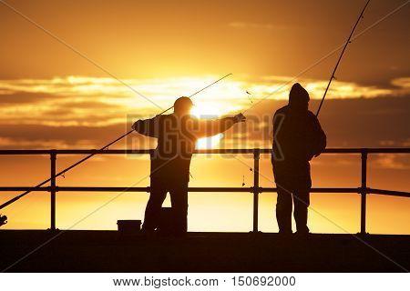 Fishing men at Mordialloc Beach Port Phillip Bay Melbourne Australia