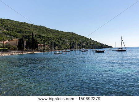 Shore of the Lake Garda in the village of Torri del Benaco in Italy