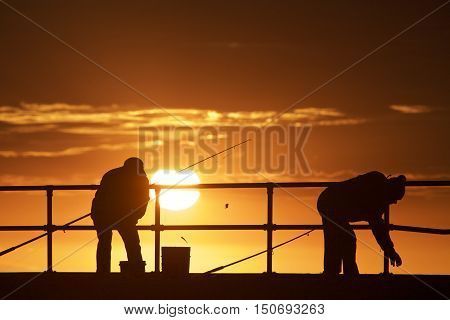 Fishing men at Mordialloc Beach Port Phillip Bay, Melbourne,Australia
