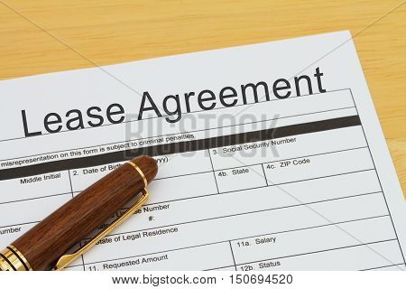 Applying for a Lease Agreement Lease Agreement application form with a pen on a desk
