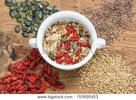 Healthy superfoods. Oatmeal with goji berries linseed pumpkinseed. Muesli breakfast