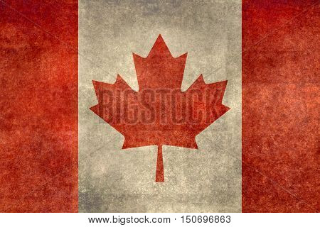 Canadian national flag with a worn distressed vintage grungy treatment.