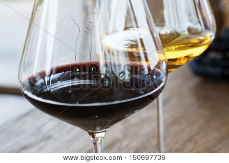 Glasses of Red and White Wine Close Up on Wooden Background