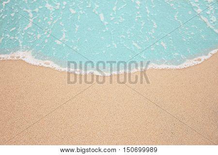Tropical beach in Thailand,Sea foam on beach,soft wave of blue ocean on Sandy beach.