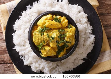 Chicken Korma On A Mildly Spiced Creamy Sauce Close-up. Horizontal Top View