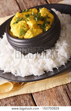 Chicken Korma Of Coconut And Cream Sauce Served In A Rice. Vertical