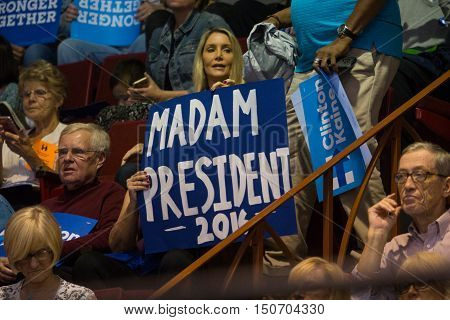 Harrisburg PA USA - October 4 2016: Supporter holding a Madam President 2016 sign at the rally for Presidential candidate Hillary Clinton.