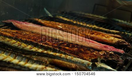 eel cooked on barbecue in Comacchio, Italy