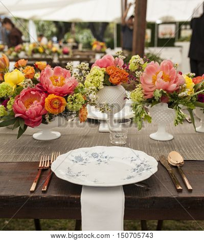 antique place setting and flowers for wedding reception