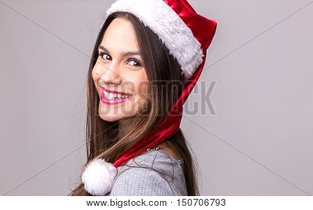 Latina girl in santa hat. Christmas theme