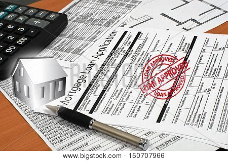 approved application for a mortgage loan is on the table other documentation pen house layout