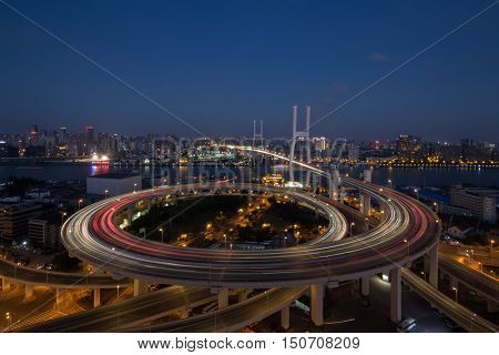Huangpu Bridge and large transport interchange with illumination at dark night