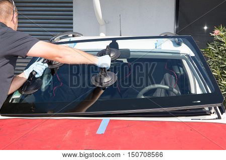 Windshield replacement man is repairing a windshield