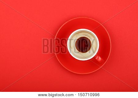 One Empty Espresso Coffee Cup With Saucer On Red