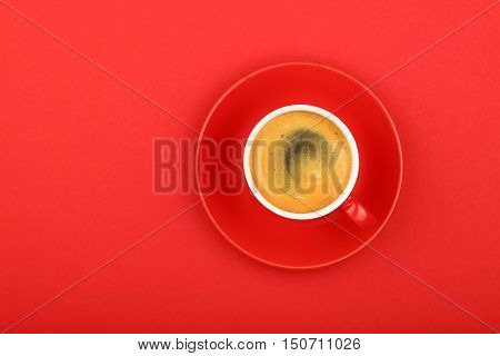 One Espresso Coffee In Cup With Saucer On Red