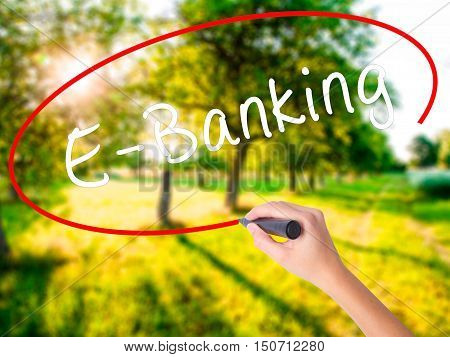 Woman Hand Writing E-banking With A Marker Over Transparent Board