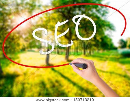 Woman Hand Writing Seo With Marker On Transparent Wipe Board