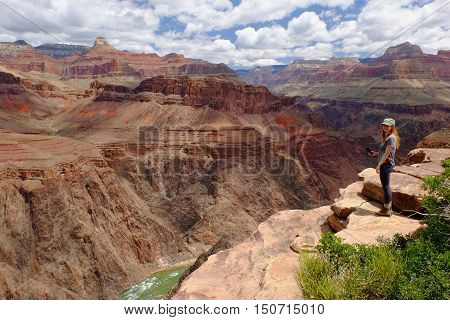 A Woman Hiker In The Grand Canyon. Grand Canyon National Park, South Rim, Arizona
