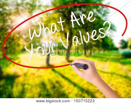 Woman Hand Writing What Are Your Values? With A Marker Over Transparent Board