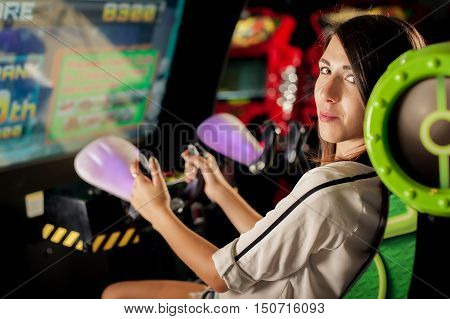Young Woman Have Fun On The Game Room