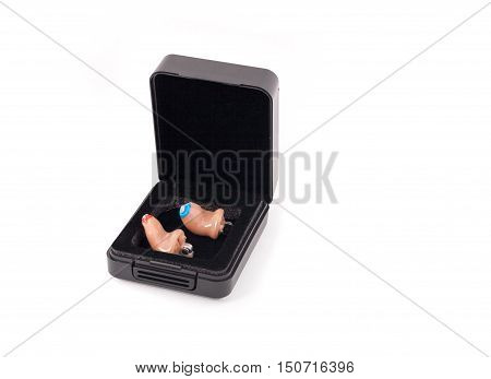 Pair of hearing aids (left and right) in a box.