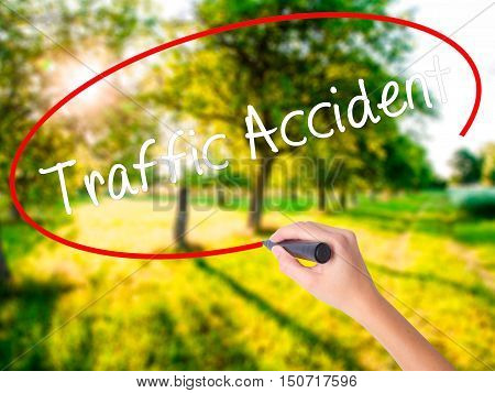 Woman Hand Writing Traffic Accident With A Marker Over Transparent Board